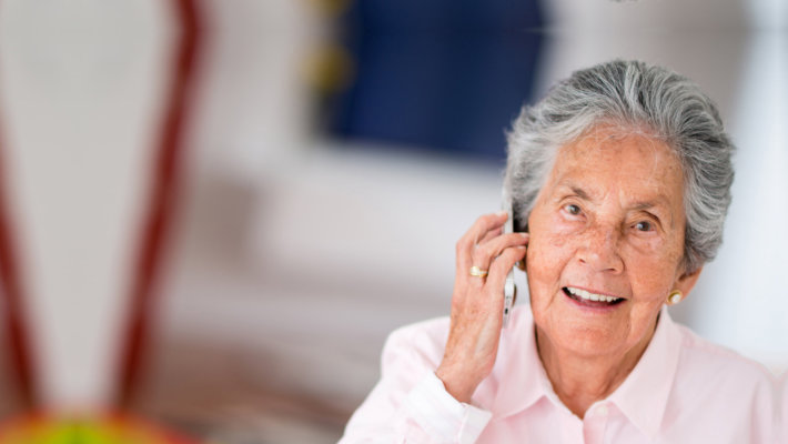 old woman calling using her smartphone